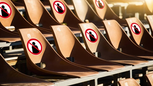 Seats with prohibition signs. Social distancing during public events